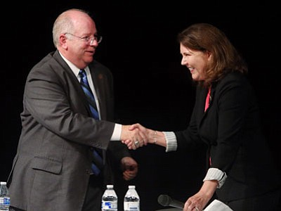 Democratic incumbent Ann Kirkpatrick, right, and Republican challenger Andy Tobin shake hands following a Congressional District 1 debate Tuesday, Oct. 14, 2014, at Mountain View High School in Tucson, Ariz. (Associated Press photo/Arizona Daily Star, Mike Christy)