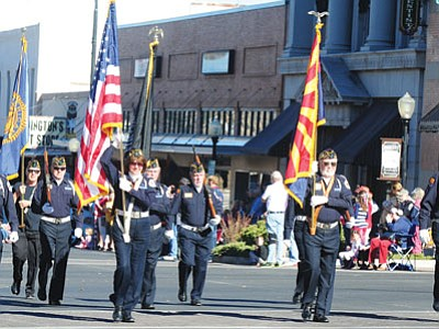 The American Legion Post 6 Color Guard marches in the 2013 Veterans Day Parade in downtown Prescott. (Les Stukenberg/The Daily Courier)