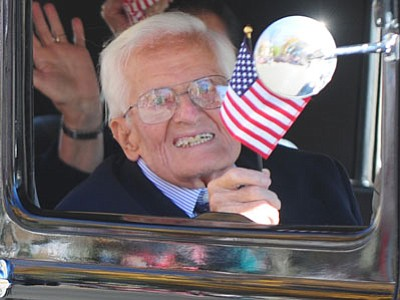 Grand MarshallGeorge Dworshak, a World War II veteran, waves during the Veterans Day Parade. It was also Dworshak's 100th birthday Tuesday. (Les Stukenberg/The Daily Courier)