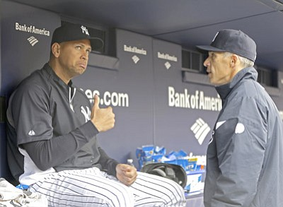 Kathy Willens/The Associated Press<br>In this April 13, 2013, file photo, Alex Rodriguez, who is on the disabled list after his hip surgery, talks to Yankees manager Joe Girardi in New York. Girardi won't know until March what to expect of Alex Rodriguez in 2015. Rodriguez was limited to 44 games in 2013 following hip surgery, then was suspended for all of this season for violations of baseball's drug agreement and labor contract.