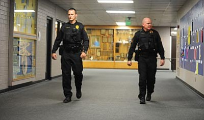 Les Stukenberg/The Daily Courier<br>Prescott Police officers Andrew Hoffman and Sgt. Ben Scott are part of the increased police presence at Prescott High School due to a possible school shooting threat that was found on Monday.