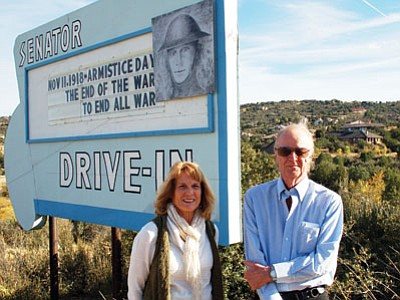 Jane Orr and Stephen Rogers – both 1963 graduates of Prescott High School – stand in front of the Senator Drive-In sign on Senator Highway. The two friends were instrumental in getting the old drive-in theater sign restored and reinstalled after it was taken down in 2008. They now help to oversee the changing messages on the sign. (Cindy Barks/Daily Courier)