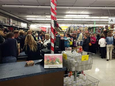 The checkout lines at Prescott True Value Hardware were crowded Thursday evening as the store held its annual Ladies Night Christmas Party event. (Deanna Allen/The Daily Courier)