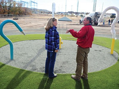 Prescott resident Linda Nichols, who won Beneful's Dream Dog Park contest in 2013, and City of Prescott Recreation Services Director Joe Baynes talk about the water feature Wednesday as the remodeled dog park takes shape in anticipation of its grand reopening Dec. 10. (Les Stukenberg/The Daily Courier)
