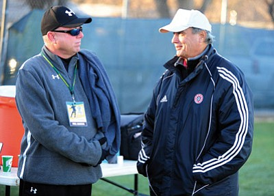 Les Stukenberg/The Daily Courier<br>Yavapai College head soccer coach Mike Pantalione, right, talks with Tyler Junior College head soccer coach Steve Clements before Tyler played Pima Thursday at Ken Lindley Field in Prescott.