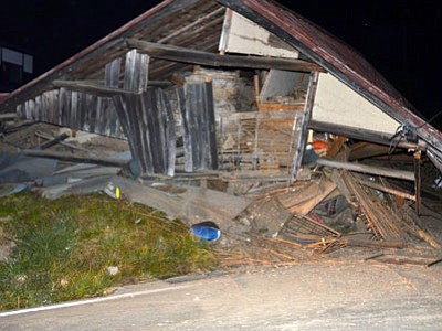 A house collapsed after a strong earthquake hit Hakuba, Nagano Prefecture, central Japan on Saturday, Nov. 22, 2014. (Associated Press photo/Kyodo News)