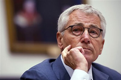 In this Sept. 18, 2014 file photo, Secretary of Defense Chuck Hagel testifies before the House Armed Services Committee on Capitol Hill in Washington. Administration sources say that Defense Secretary Chuck Hagel is resigning from President Barack Obama's Cabinet. (AP Photo/Cliff Owen)