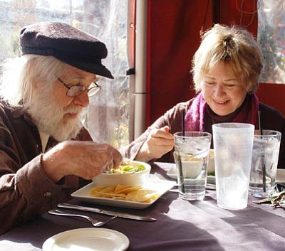 Scott Orr/The Daily Courier<br>Roger and Elaine Murray dine at El Gato Azul on Sunday.