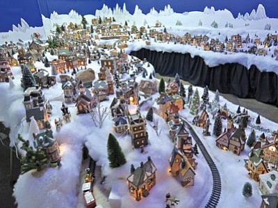 Enchanted Christmas at Frontier Village Shopping Center in Prescott features an elaborate miniature village display.