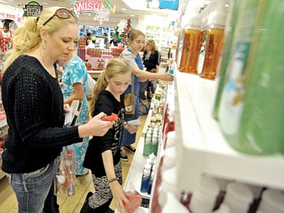 Bridgette Cole and her daughter Brooklyn shop together at Bath & Body Works in the Prescott Gateway Mall on Black Friday. (Matt Hinshaw/The Daily Courier)