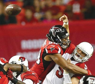 John Bazemore/The Associated Press<br>Atlanta Falcons defensive end Stansly Maponga hits Arizona Cardinals quarterback Drew Stanton causing a fumble, during their game Sunday.
