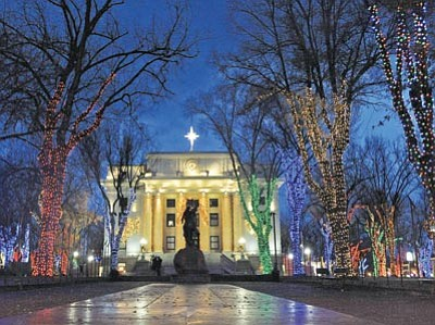 Matt Hinshaw/The Daily Courier<br> Courthouse lighting organizers turn on the Christmas lights on the plaza for a one-hour trial run Tuesday night in preparation for Saturday's 60th Courthouse Lighting event.