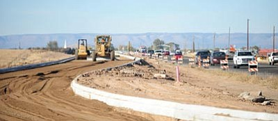 Les Stukenberg/The Daily Courier<br> Heavy equipment works on what will eventually be the southbound lanes of Highway 89 as work progresses Thursday.