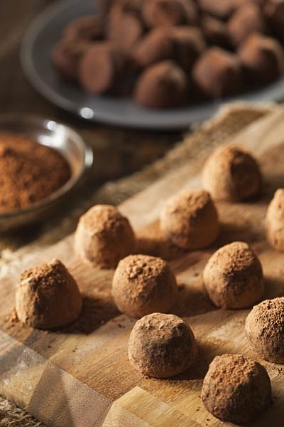 Thinkstock<br> Kids love to roll truffles in their choice of coating. Use a mellon baller to keep the truffles uniform in size and shape.