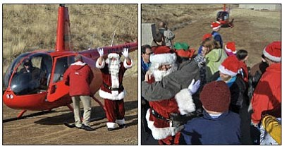 Matt Hinshaw/The Daily Courier<br>Right, Santa Claus receives a hug while making his way through the crowd after a Guidance Aviation helicopter brought him in for a visit at the Ruger Airpark Industries building Friday afternoon in Prescott. Clients, co-workers, and employees of the three area Yavapai Exceptional Industries facilities converged on their airpark location to welcome Santa Claus and have their photo taken with him. This is the third year that YEI and Guidance Aviation partnered together to fly Santa Claus in for a visit.