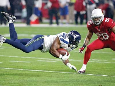 Ross D. Franklin/The Associated Press<br> Seattle Seahawks running back Robert Turbin goes for extra yards as Arizona Cardinals free safety Rashad Johnson defends on Sunday in Glendale.