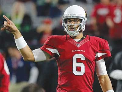 Rick Scuteri/The Associated Press<br> Arizona Cardinals quarterback Logan Thomas looks to the sideline for direction during Sunday's game against the Seattle Seahawks.