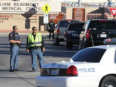 The El Paso Times, Victor Calzada/The AP<br> Police officers guard an entrance to the Beaumont Army Medical Center/El Paso VA campus during the search for a gunman Tuesday. The gunman is dead.