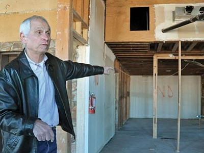 Matt Hinshaw/The Daily Courier<br>Architect Frank DeGrazia talks about the future Elks Opera House Phase 2 renovations on the third floor of the building that formerly housed offices Tuesday morning in downtown Prescott.  DeGrazia estimates that the Phase 2 renovations could take up to a year if not longer to complete.