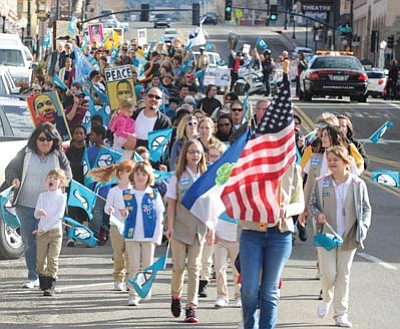 Les Stukenberg/The Daily Courier<br>Over 400 people march through downtown Prescott to honor Martin Luther King on Monday.