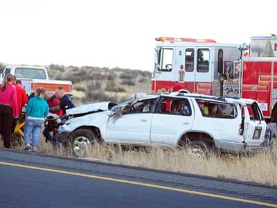Les Stukenberg/The Daily Courier<br> Emergency personnel move the victim of a one-vehicle rollover on HIghway 89A just east of the Granite Dells Parkway to an ambulance where she was then transported to a helicopter early Tuesday evening.