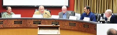 Les Stukenberg/The Daily Courier<br>The local Public Safety Personnel Retirement System Board votes to move into executive session during the hearing of whether Granite Mountain Hotshots Billy Warenke and Sean Misner were eligible to be included in the retirement system Wednesday.