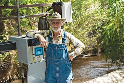 """Courtesy Mark Skalny/TNC<br> Frank Germinden, a Camp Verde landowner and volunteer """"ditch guy,"""" shows off the new automated ditch flow system."""