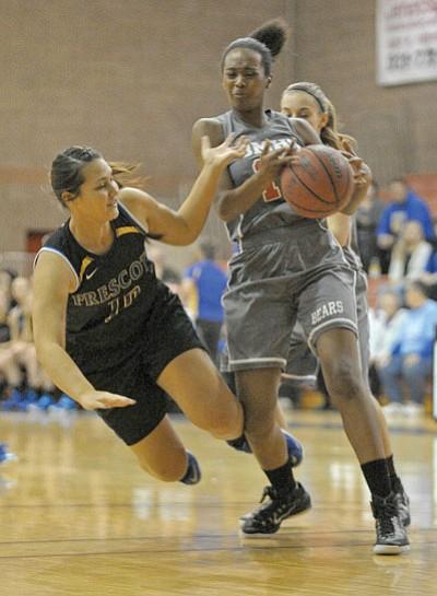 Matt Hinshaw/The Daily Courier<br>Bradshaw's Kyra McNeil (11) grabs the ball away from Prescott's Haley Crozier (10) Thursday night.