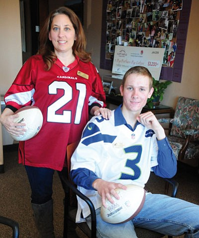 Les Stukenberg/The Daily Courier<br>Justin Corbell poses with his boss Lisa Sahady at the Yavapai Big Brothers Big Sisters office in Prescott on Jan. 22. Sahady heard that a local man had an extra ticket to the Super Bowl in Glandale and recommended that Corbell be the reciepient.