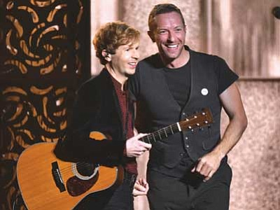 John Shearer/Invision/AP<br> Beck, left, and Chris Martin perform at the 57th annual Grammy Awards on Sunday in Los Angeles. Beck won Album of the Year.