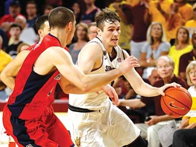 Rick Scuteri/The Associated Press<br> Arizona State guard Bo Barnes, right, drives past Arizona guard T.J. McConnell during their game Saturday in Tempe.