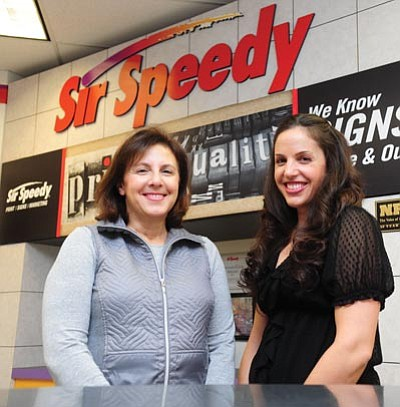 Les Stukenberg/The Daily Courier<br>Sir Speedy's new owner Danielle Rickert, at right, and her mother Lisa Rickert, who does the books there, at the Prescott location on Commerce Center Circle in Prescott.