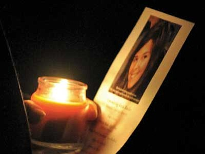 Matt Hinshaw/The Daily Courier<br> Eva Ekdahl holds a candle and a photo of Kayla Mueller during the Remembering Kayla Mueller Community Candlelight Memorial Wednesday, Feb. 18, at the courthouse plaza in downtown Prescott.