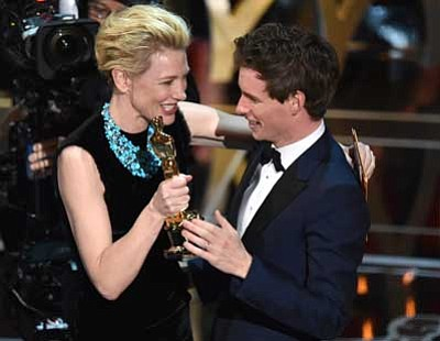 "John Shearer/Invision/AP<br> Cate Blanchett, above left, presents Eddie Redmayne with the award for best actor in a leading role for ""The Theory of Everything"" at the Oscars on Sunday."