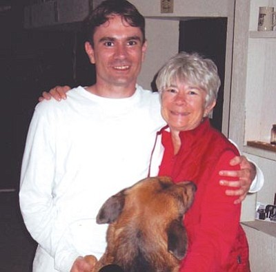 Courtesy photo<br>Andrew Zorn with his mother, Sally Schindel, and his German Shepherd mix Tritium.
