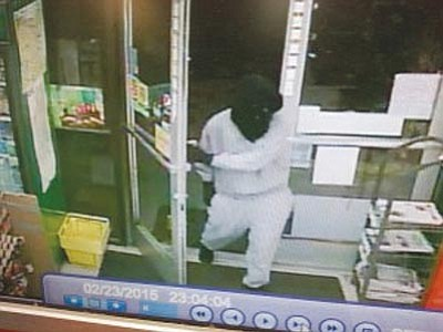 Prescott Police/Courtesy image<br> An image from surveillance video reportedly shows the robber entering the store.