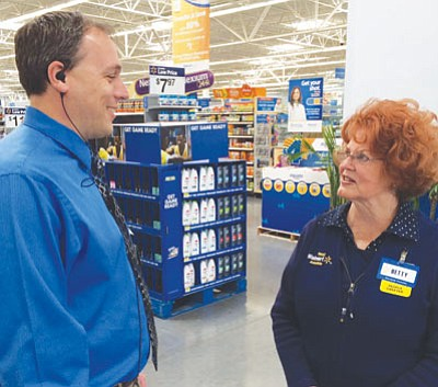 Max Efrein/The Daily Courier<br /><br /><!-- 1upcrlf2 -->Prescott Valley Wal-Mart Supercenter manager Kevin Ray talks with one of his fellow Wal-Mart associates, Betty Davis.