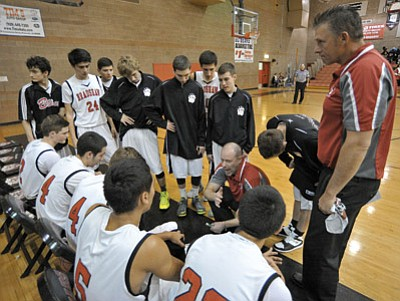 Matt Hinshaw/The Daily Courier<br>After 14 years and exactly 200 wins with the Bradshaw Mountain boys' basketball program, Doug Beilfuss, seen leading the huddle back on Jan. 16 in Prescott Valley, is leaving his post to become the new assistant men's basketball coach at Embry-Riddle.