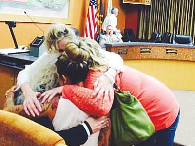 Cindy Barks/The Daily Courier<br>Hotshot widow Juliann Ashcraft, center, is congratulated by family members Tuesday, March 10.