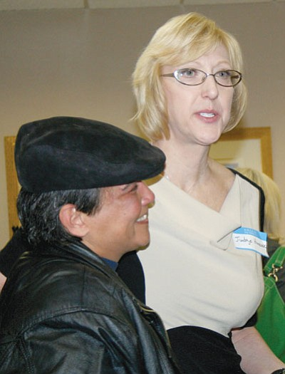 PNI Photo/Sue Tone<br /><br /><!-- 1upcrlf2 -->Yavapai County Judge Cele Hancock, right, thanks probationer Terry who talked about her journey through Mental Health Court at the March 7 meeting of the League of Women Voters.