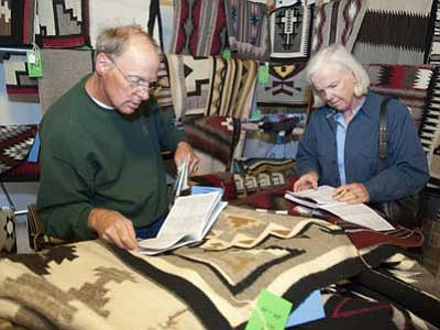 Les Stukenberg/The Daily Courier, file<br> Rich and Sue Cottine check out the selection of Navajo rugs being auctioned in the 2012 Smoki Museum Rug and Art in Prescott. This year's event is Saturday, March 21.