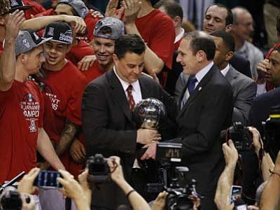 John Locher/The Associated Press<br> Arizona head coach Sean Miller holds the Pac-12 championship trophy after his team defeated Oregon 80-52. The Wildcats enter the NCAA tourney this week as the No. 2 West seed.