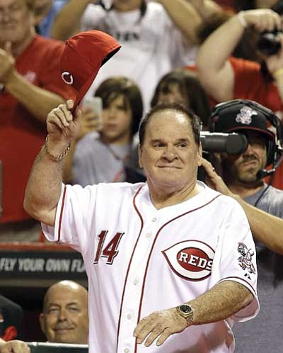 Al Behrman, file/The AP<br>  Former Cincinnati Red great Pete Rose walks onto the field during 2013 ceremonies honoring the starting eight of the 1975-76 World Champion Reds in Cincinnati. Rose, banned from baseball since 1989, has submitted a new request to be reinstated.