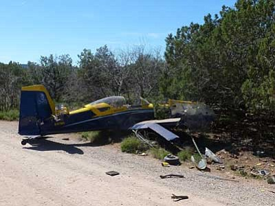Gary Johnson, courtesy photo/The AP<br> This photo provided by Sedona Fire Department spokesman Gary Johnson shows a single-engine plane that lost control after attempting an emergency landing in Sedona on Saturday, March 21. The plane's two occupants suffered non-life-threatening injuries.