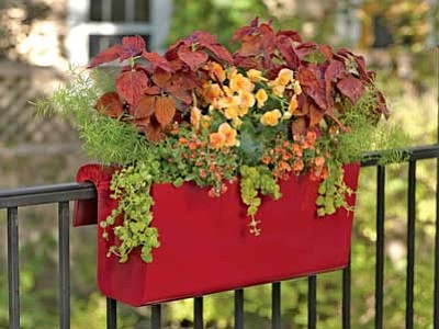 Gardener's Supply Company/Courtesy photo<br> Railing planters filled with colorful combinations can add sparkle to balconies, decks and porches.