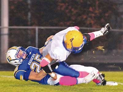 Matt Hinshaw/The Daily Courier, file<br> Tyler Bruso (25), seen sacking Kingman quarterback Jose Moreno back on Oct. 2, 2014, at PHS, earlier this month was awarded a scholar athlete award from the National Football Foundation.