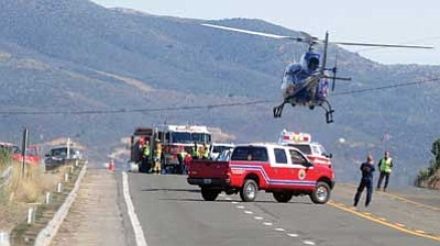 Les Stukenberg/The Daily Courier<br> A two-vehicle collision closed Highway 69 near the Orchard Ranch RV Park in Prescott Valley Monday, March 30. The collision sent one person to John C Lincoln North Hospital via helicopter with serious injuries.