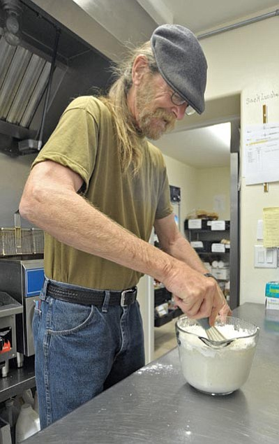 Kent Robinson, a student in the U.S. VETS nonprofit organization's culinary program, helps prepare dinner Monday evening at U.S. VETS in Prescott March 23. (Matt Hinshaw/The Daily Courier)