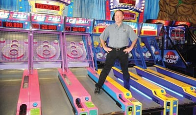 Les Stukenberg/The Daily Courier<br>Chad Cook, owner of Freedom Station Family Fun Center in Prescott Valley's Entertainment District.