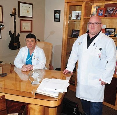 Les Stukenberg/The Daily Courier<br>Yavapai Cardiac Surgery surgeons Dr. Pierre Tibi and Dr. Jose Torres in Dr. Tibi's Prescott office.